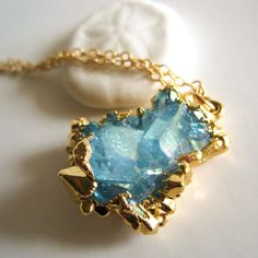 "I'm not a big fan of gold, but I'm really liking this ""natural crystal dipped in metal"" thing that's becoming popular.  It's kinda gorgeous.    Aqua Quartz Cluster Necklace  by Kahili Creations"