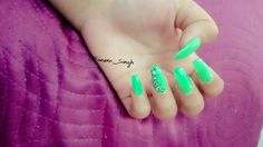 Acrylic neon green glow in the dark with black and white half design leopard print on index finger