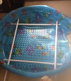 Easy to make Whelping box.  Puncture holes in kiddie pool, use PVC pipes to make railing.