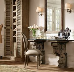 repurposed an exterior architectural detail from the Classical period, using rustic corbels with an antiqued finish to create a striking desk.