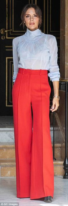 Upping the ante: The Spice Girl donned a pair of red wide-leg trousers, tied in with her platform heels