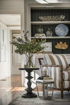 striped chair, side table with lantern