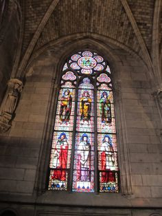 Paris, France - inside Notre-Dame 1163, a stain glass window located on the very back wall
