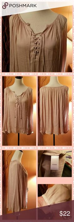 Lace up peasant top. The color is called Jennifer pink. It is a very pale pink color, almost a nude color. The material is soft and silky. This top is very flowy and beautiful. Machine washable. Jennifer Lopez Tops Blouses