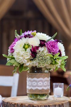 Purple and white flower arrangement in burlap + lace-wrapped mason jar - Rustic chic! {Jennifer Weems Photography}