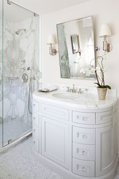 Book matched marble in the shower . Sunset Plaza by Smith Firestone Associates