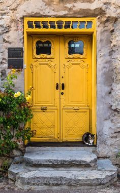 Yellow door with a little gate keeper in the medieval town of Visby, Gotland, Sweden.