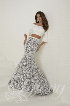 0769aad9d8 Tiffany Designs 16272 is a two-piece prom dress with an off the shoulder  jersey crop top with elbow length bell sleeves and a floor length velvet  brocade ...
