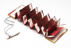 Mari Emily Bohley, accordion book with calligraphy. Closure with calligraphy pen.