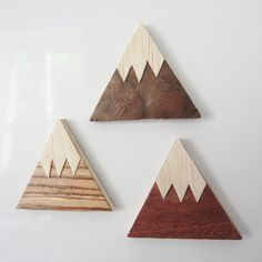 A set of 3 handmade wooden magnets. Plywood triangles covered in 3 different wood veneers, cut by hand (not by laser!) and varnished for protection. Classic Amokori snow capped mountain design. Useful for attaching notes to your fridge or other metal surface but also look beautiful when simply displayed as stylish decoration. Powerful neodymium magnet (N52 grade) inserted in reverse of each plywood triangle.  The nature of wood and the hand finish means that each one is very slightly…