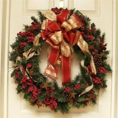 """24"""" Grande Christmas Pine and Berry Wreath wi/ Designer Bow by Home Decor. $74.50. Measures 24"""" across. Shipped Insured. Brand new!. Hand crafted quality. This simple wreath is filled with red berries, pinecones set on a natural look pine wreath base. The mixed bow adds a lovely addition to this simple wreath. Features:. Save 56% Off!"""