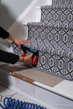 How to Install a Stair Runner - Use a pneumatic stapler to attach the stair runner to the underside of the tread nose, which will help disguise the staples. - Thrift Diving Wood Stairs, Basement Stairs, House Stairs, Carpet Stairs, Stairs With Carpet Runner, Painted Stairs, Basement Ideas, Staircase Makeover, Staircase Remodel