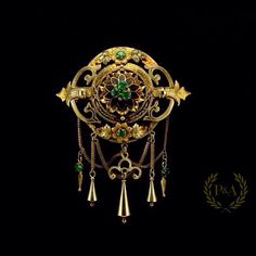 Victorian emeralds gold brooch ⚜ CONTACT US FOR MORE INFORMATION   REF NUMBER:8532 SIZE:cm. 5,8 x 7,5 ( inch 2,3 x 2,9 ) WEIGHT:gr. 17,4    Description: An intricated and detailed hand work gold for this antique brooch.Victorian period.  7 emeralds. The gold is also cutted and engraved. Very fine piece. Can be French or Belgian. #jewellery  #brooches #antiquebrooch #preciousandantique #emeralds #antiquejewelry #jewels #goldjewelry #victorianjewelry #victorianbrooch
