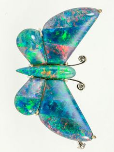 An opal doublet butterfly brooch, designed as a butterfly with out-stretched wings, set throughout with cabochon black opal doublet cut to the shape of the wings and body, the antennae each tipped with a circular-cut diamond, wingspan gross weight grams. Insect Jewelry, Butterfly Jewelry, Opal Jewelry, Vintage Jewelry, Unique Jewelry, My Birthstone, Antique Brooches, October Birth Stone, Australian Opal