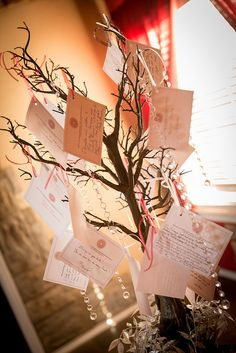"""A MEMORY TREE: """"We couldn't have everyone we wanted attend, so we did a Memory Tree. We sent out cards to those who could not attend and had them send them back with a wish, piece of advice, story, or blessing. We added them to the tree on our altar. We also added names of people who passed away."""""""