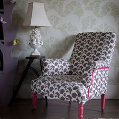 Rapture and Wright -  Rapture and Wright Collection - A grey and white cloud print armchair with painted candy pink feet,a small dark wood table and an ornate white lamp