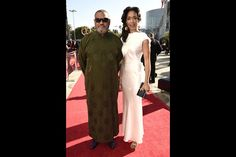 Laurence Fishburne and Gina Torres on the red carpet at the 2016 Primetime…