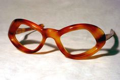 1960's light tort. plastic frame marked  EYEWEAR BY WEITZMAN & FRAME FRANCE