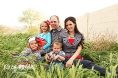 An example of what to wear for family photos. Pick a color scheme and choose pieces within it.