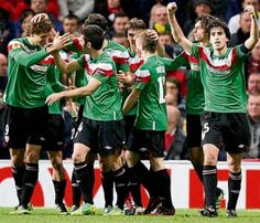 """Athletic Bilbao celebrate at Old Trafford. Working with only Basque players, """"El Loco"""", Marcelo Bielsa has radically transformed the club's style and turned them into a new force in Spanish football. They are also exhilarating to watch."""