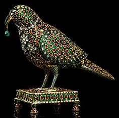 AN EXCEPTIONAL EMERALD, RUBY AND DIAMOND-INSET ENAMELLED GOLD PARROT