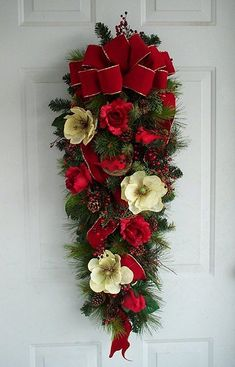 Cardinal Holiday Christmas Door Swag - A mixed pine base covered with red berries, pine cones, pretty red roses and magnolias accented with cardinals perched in their nest. by muriel Christmas Swags, Christmas Door Decorations, Christmas Flowers, Christmas Centerpieces, Holiday Wreaths, Christmas Holidays, Christmas Crafts, Christmas Ornaments, Ball Ornaments