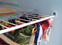 Clean up the freezer by clipping open bags to the bottom of freezer shelves. This ensures that the bags are not buried in the back and you can take advantage of extra space in the freezer.