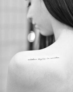 """Wisdom begins in wonder"" tattoo on the left shoulder blade. Tattoo Artist: Drag"