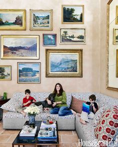 In the living room of her Locust Valley, New York, home, Ellen Niven nestles in with sons Wyck and Stuart Deery and their lab, Georgia. Bold-pattern pillows cozy up a custom banquette by Le Décor Français covered in Le Manach's Greuze.