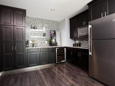 Efficient Kitchenette- Not white but dark enough to make it beautiful - Rockin' Renos from Property Brothers