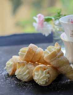 Childhood favourite, Custard Cream Horns recipe. Easy to bake using store-bought puff pastry.