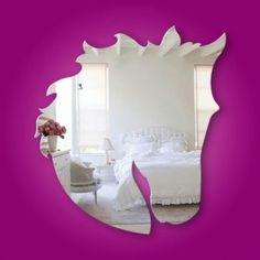 Beautiful Horse Head mirror. They are made from a safety mirror acrylic. Light weight and shatterproof. These mirrors have self adhesive back so no drilling or nails :) Dimensions are 560mm by 400mm. Perfect for any Room.