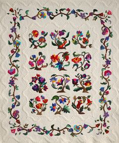 This jacobean flower garden uses applique, stippling, feathers, and McTavishing. Credits: Patricia Ribich's quilt - quilted by Karen McTavish.