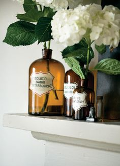 vintage tonic bottles as vases