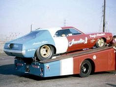 Doug Thorley's rear engine 1968 AMC Javelin funny car. Nice transport rig too.