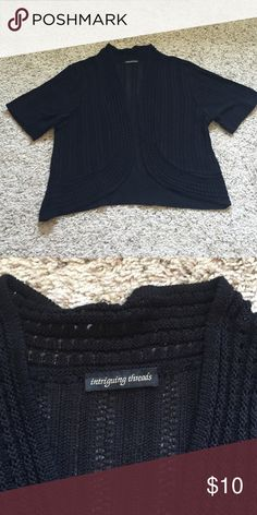 Basic Black Knit Shrug Basic black knit fabric shrug. Mid length / tee shirt length sleeves. Size large or XL. In great condition!!! Sweaters Shrugs & Ponchos