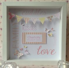 This beautiful, bespoke frame features a string of miniature bunting flags, delicate fluttering butterflies and a raised personalised plaque.