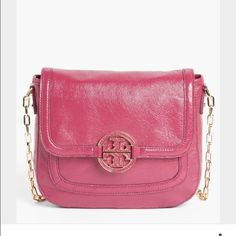 Tory Burch Amanda Crossbody Bag Super cute and functional Crossbody purse--seriously has SO many useful pockets/compartments! slight wear on the gold hardware but the purse is in overall good condition. Color is Royal fuschia, it's perfect for spring/summer and adds an awesome pop of color to any outfit. Tory Burch Bags Crossbody Bags