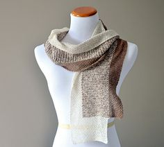 This scarf is very light and soft. Shibui Pebble has a subtle texture that creates a really lovely fabric. I highly recommend using it for this design. Two skeins are required: one each of 2 different colors.