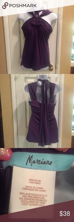 Purple Marciano tank top Purple Marciano tank top, this flirty top is perfect for those hot summer days. It can be dressed down with jeans, or dressed up with a great pair of wedges. I love this top, my closet is just too full. Marciano Tops Camisoles