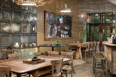 eco friendly coffee shop interior design ideas. Like the use of metal ceiling tiles on the wall