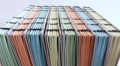 coptic stitch notebooks with simple recycled board covers by immaginacija, via Flickr