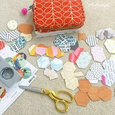 """Since cleaning is no fun I am camped out on my floor and making my """"paper buffet"""". If you saw it in the Creative Planner Workshop (you can sign up still link is in my bio) you remember that I love to create a whole tray of punched and cut shapes out of paper. I use this tray of paper to decorate my @inkwellpress planners. It is so fun to punch and cut paper and I love gathering up my favorite patterns to create new looks. Just spending an hour or two doing this gives you enough bits to use…"""