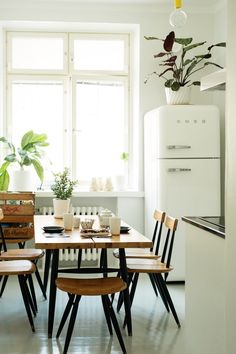 Smeg, old radiator, modern chairs, white, lots of light