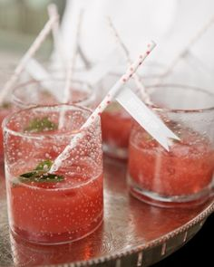 "Signature sip: This couple served the ""Ever After,"" a strawberry mint mojito finished with a red and white paper straw with a gray pennant flag that read ""Cheers!"" or ""Bottoms Up!"""
