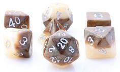 Get ready to roll with Halfsies Dice (Latte). This RPG dice set has all your favorites: d4, d6, d8, d10, d%, d12, and d20. Halfsies are an exciting new line of role playing dice ready for your greates