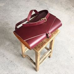 Our cherry red shoulder bag - structured spacious and hangs perfectly at the hip. #satchelbag #redleather #shoulderbag #minimalistbag #structuredesign #carvlondon
