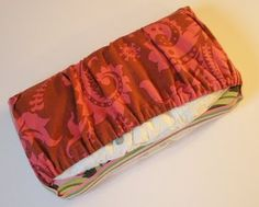 Wipes case with a diaper pocket. Minimal sewing involved.