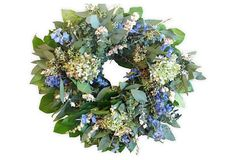 "18"" Eucalyptus & Hydrangea Wreath Crafted with salal, baby blue eucalyptus, and limelight hydrangea among other beautiful blossoms, this wreath will add color and freshness to its surroundings.  From The Garden specializes in beautiful, modern designs of dried and preserved floral wreaths and arrangements.  Keep indoors out of direct sunlight and heating elements."