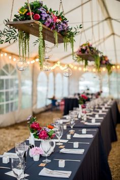 Tent wedding decor with Hanging centerpiece.
